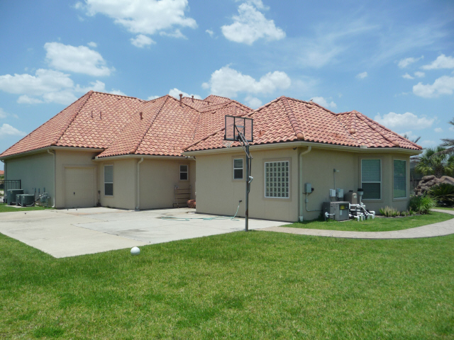 Tile Roof in Katy Texas cleaned by Katy Memorial Roof Cleaning and Power Washing on June 1st 2011